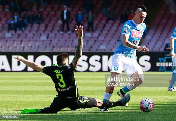 Napoli's Slovak forward Marek Hamsik fights for the ball with Verona's Italian defender Eros Pisano during the Italian Serie A football match between...