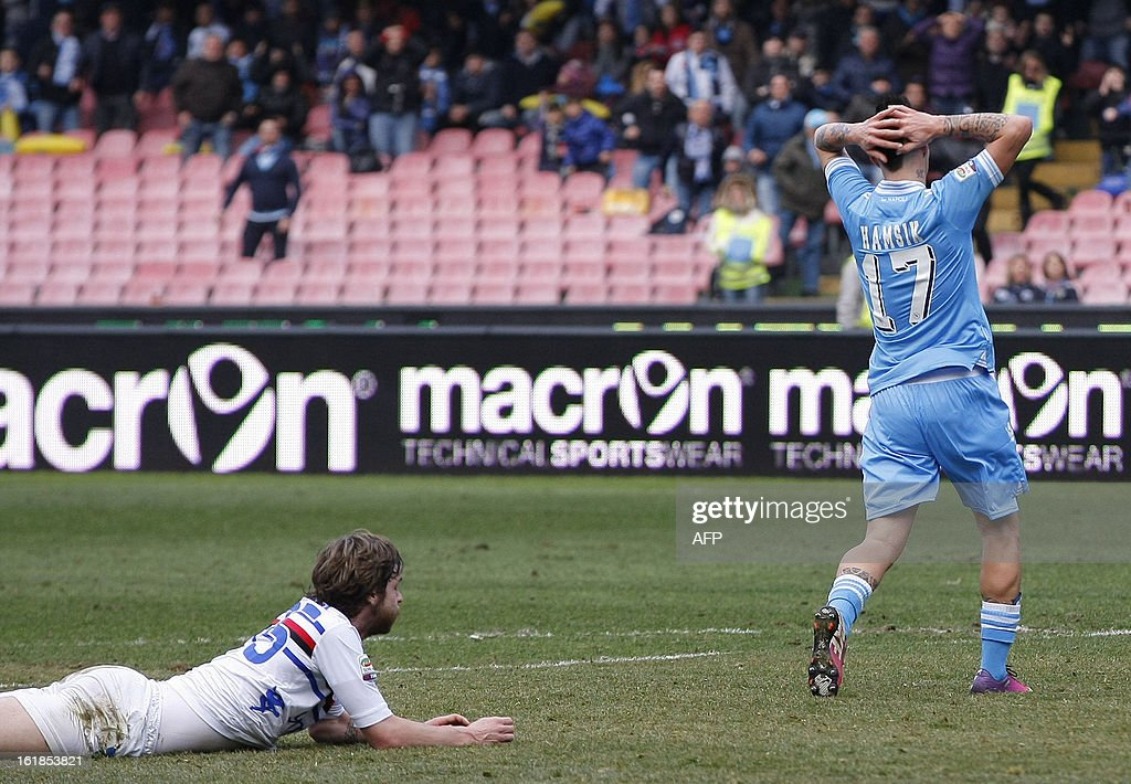 Napoli's Slovak forward Marek Hamsik (R) reacts after missing a goal as Sampdoria's Swiss defender Jonathan Rossini lies on the ground during the Italian Serie A football match SSC Napoli vs UC Sampdoria in San Paolo Stadium on February 17, 2013 in Naples. AFP PHOTO / CARLO HERMANN