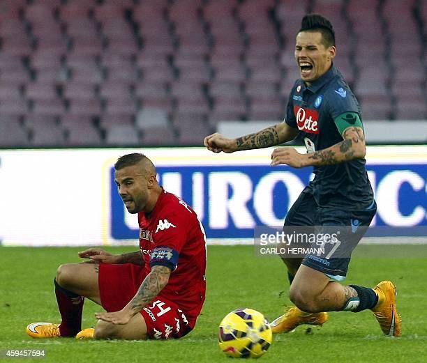 Napoli's Slovak forward Marek Hamsik vies with Cagliari's Italian defender Francesco Pisano during the Italian Serie A football match SSC Napoli vs...