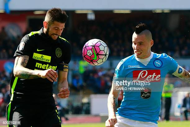 Napoli's Slovak forward Marek Hamsik vies with Verona's Italian defender Eros Pisano during the Italian Serie A football match SSC Napoli vs Hellas...