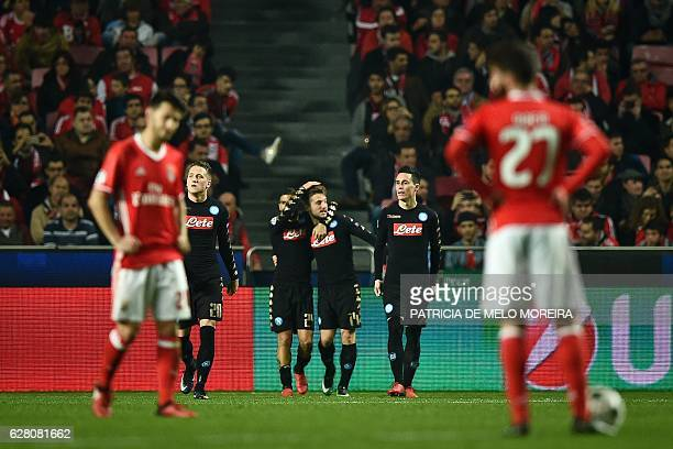 Napoli's Slovak midfielder Marek Hamsik celebrates with his teammates after scoring during the UEFA Champions League Group B football match SL...