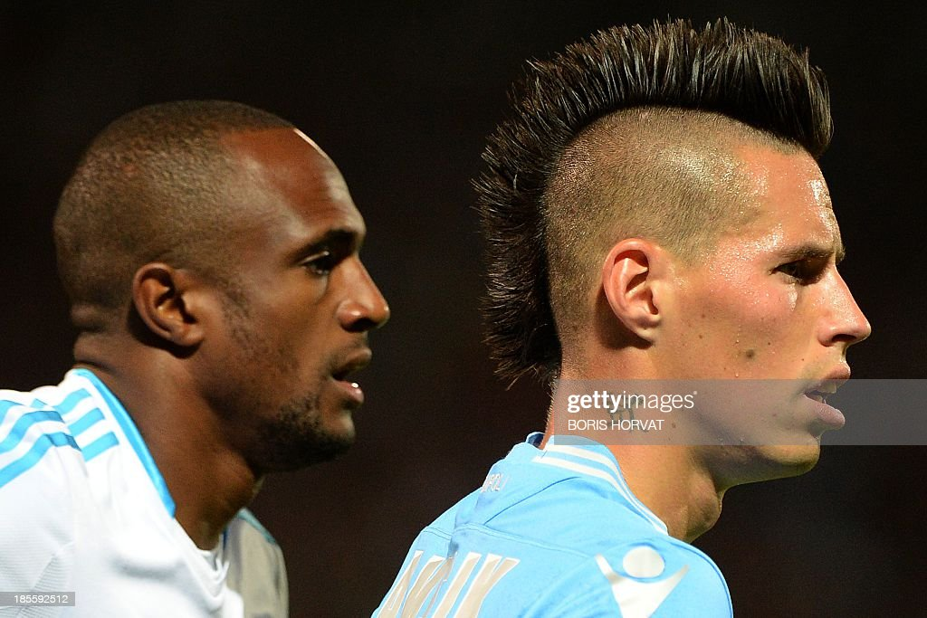 Napoli's Slovak midfielder Marek Hamsik (R) stands next to Marseille's Comoran defender Kassim Abdallah (L) on October 22, 2013 during a UEFA Champion's league Group F football match at the Velodrome stadium in the southern French city of Marseille.