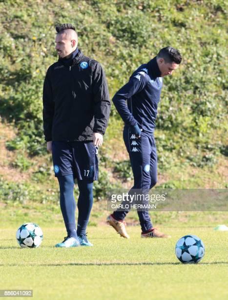 Napoli's Slovakian midfielder Marek Hamsik and Napoli's Spanish striker Jose Maria Callejon attend a training session on the eve of the UEFA...