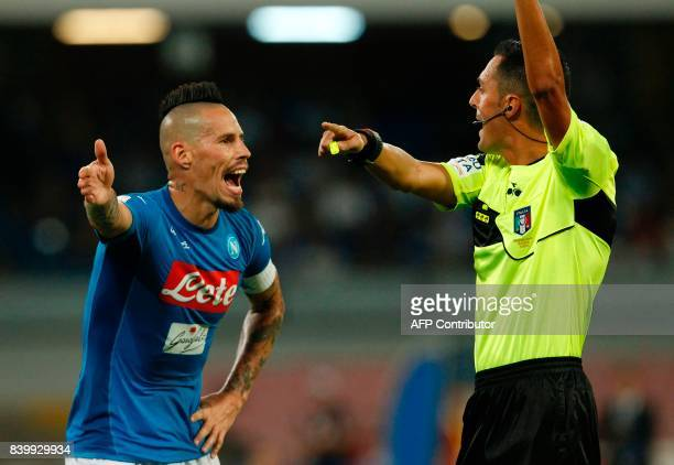 Napoli's Slovakian midfielder Marek Hamsik argues with Referee Marco Di Bello during the Italian Serie A football match SSC Napoli vs Atalanta BC on...