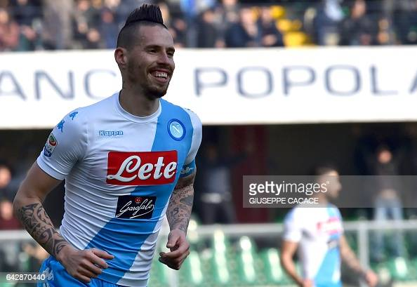 Napoli's Slovakian midfielder Marek Hamsik celebrates after scoring a goal during the Italian Serie A football match between Chievo and Napoli at the...