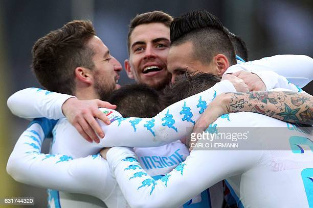 Napoli's Slovakian midfielder Marek Hamsik celebrates with his teammates after scoring a goal during the Italian Serie A football match between SSC...