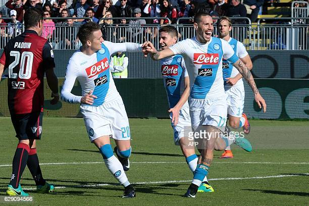 Napoli's Slovakian midfielder Marek Hamsik celebrates with teammates after scoring a goal during the Italian Serie A football match between Cagliari...