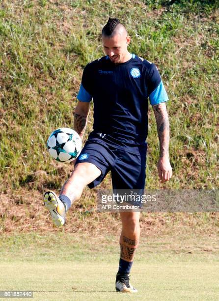 Napoli's Slovakian midfielder Marek Hamsik controls the ball during a training session on the eve of the UEFA Champions League Group F football match...