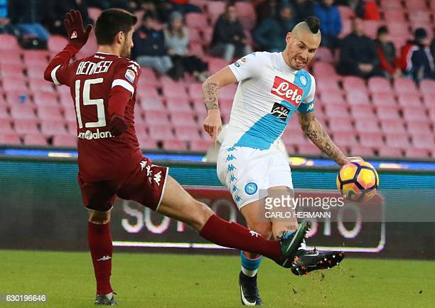 Napoli's Slovakian midfielder Marek Hamsik fights for the ball with Torino's Italian midfielder Marco Benassi during the Italian Serie A football...