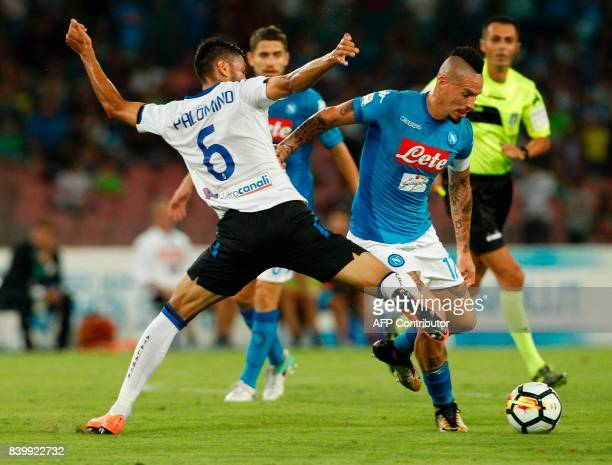Napoli's Slovakian midfielder Marek Hamsik fights for the ball with Atalanta'a Argentinian defender Jose Luis Palomino during the Italian Serie A...