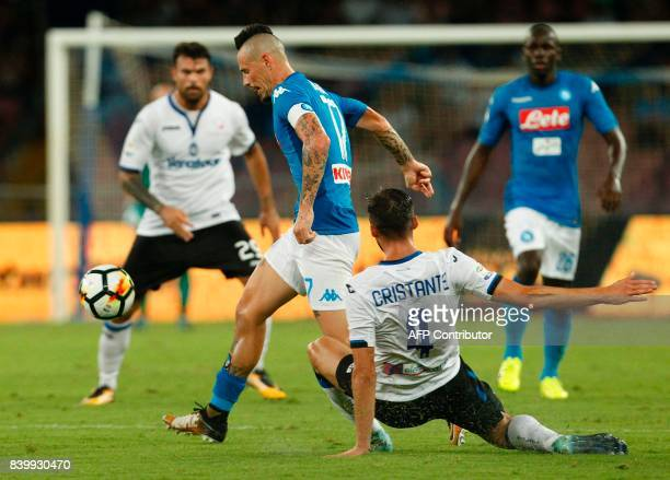 Napoli's Slovakian midfielder Marek Hamsik fights for the ball with Atalanta'a Italian midfielder Bryan Cristante during the Italian Serie A football...