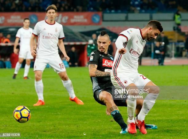 Napoli's Slovakian midfielder Marek Hamsik fights for the ball with Milan's Italian defender Alessio Romagnoli during the Italian Serie A football...