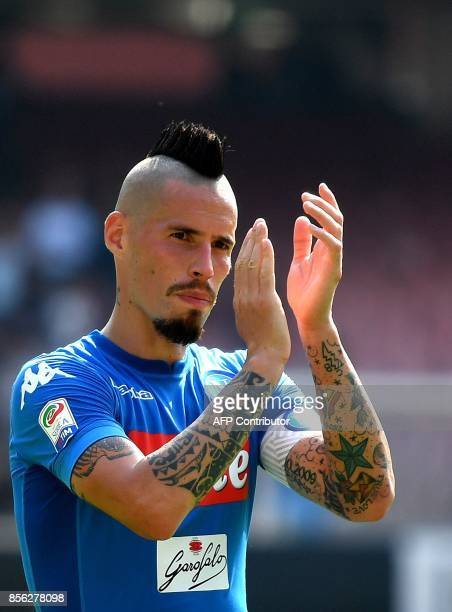 Napoli's Slovakian midfielder Marek Hamsik greets fans at the end of the Italian Serie A football match Napoli vs Cagliari on October 1 2017 at San...