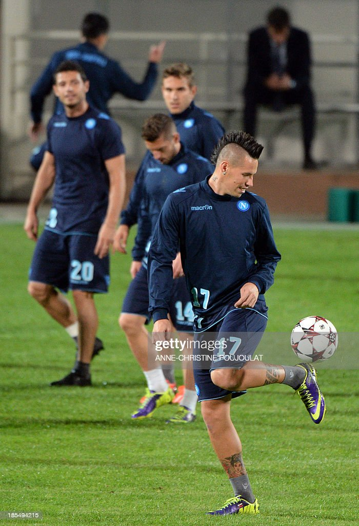 Napoli's Slovakian midfielder Marek Hamsik juggles with the ball during a training session on October 21, 2013 at the Velodrome stadium in Marseille, southern France, on the eve of the UEFA Champions League group F football match Marseille vs. Napoli.