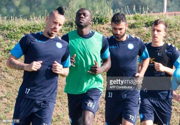 Napoli's Slovakian midfielder Marek Hamsik Napoli's French defender Kalidou Koulibaly Napoli's Spanish defender Raul Albiol and Napoli's Romanian...