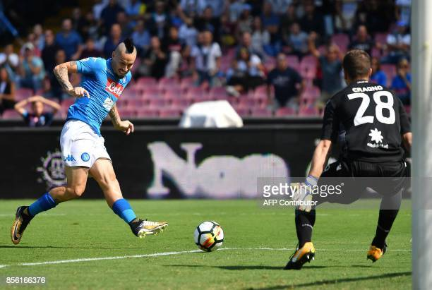 Napoli's Slovakian midfielder Marek Hamsik scores during the Italian Serie A football match Napoli vs Cagliari on October 1 2017 at San Paolo stadium...
