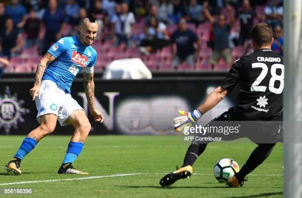 Napoli's Slovakian midfielder Marek Hamsik scores during the Italian Serie A football match Napoli vs Cagliari on October 1 2017 at San Paolo stadium...