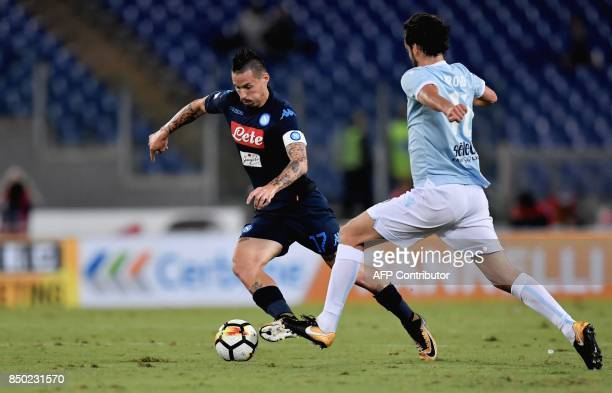 Napoli's Slovakian midfielder Marek Hamsik vies for the ball with Lazio's Italy's midfielder Marco Parolo during the Serie A football match between...
