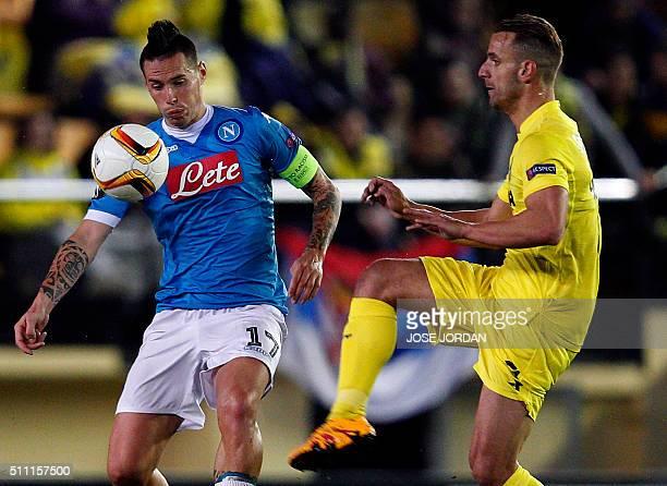 Napoli's Slovakian midfielder Marek Hamsik vies wit Villarreal's forward Roberto Soldado during the UEFA Europa League Round of 32 first leg football...