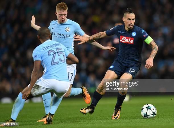 Napoli's Slovakian midfielder Marek Hamsik vies with Manchester City's Brazilian midfielder Fernandinho and Manchester City's Belgian midfielder...