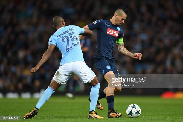 Napoli's Slovakian midfielder Marek Hamsik vies with Manchester City's Brazilian midfielder Fernandinho during the UEFA Champions League Group F...