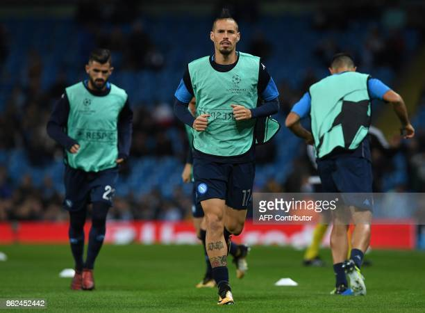 Napoli's Slovakian midfielder Marek Hamsik warms up ahead of the UEFA Champions League Group F football match between Manchester City and Napoli at...