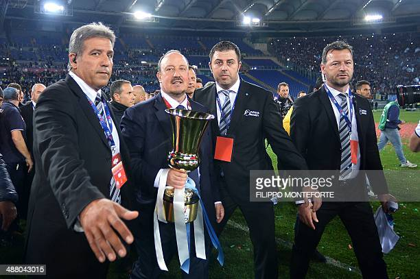 Napoli's Spanish coach Rafael Benitez holds the trophy after winning the Italian Tim Cup football final between Fiorentina and Napoli on May 3 2014...