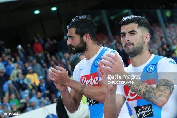 Napoli's Spanish defender Raul Albiol and Napoli's Albanian defender Elseid Hysaj greet fans at the end of the Italian Serie A football match SSC...