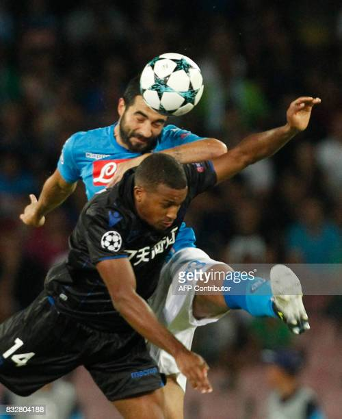 Napoli's Spanish defender Raul Albiol fights for the ball with Nice's French forward Alassane Plea during the UEFA Champions League Play Off first...