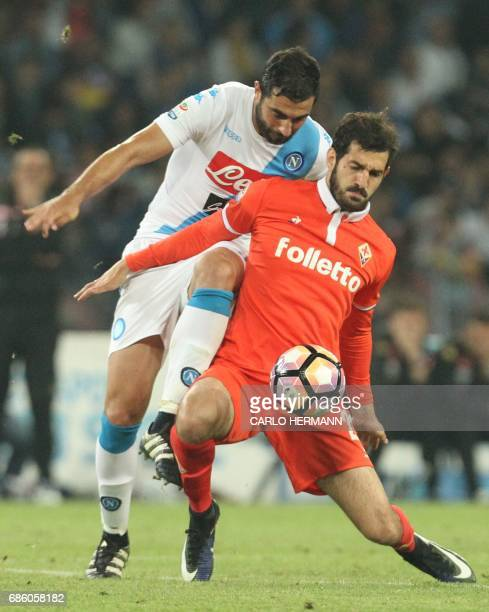 Napoli's Spanish defender Raul Albiol fights for the ball with Fiorentina's forward Riccardo Saponara during the Italian Serie A football match SSC...