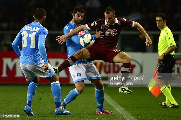 Napoli's Spanish defender Raul Albiol fights for the ball with Torino's forward Riccardo Meggiorini during the Italian Serie A football matchTorino...