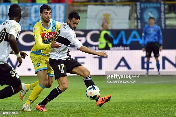 Napoli's Spanish defender Raul Albiol vies for the ball with Parma Italian forward Raffaele Palladino during the Serie A match between Parma and...