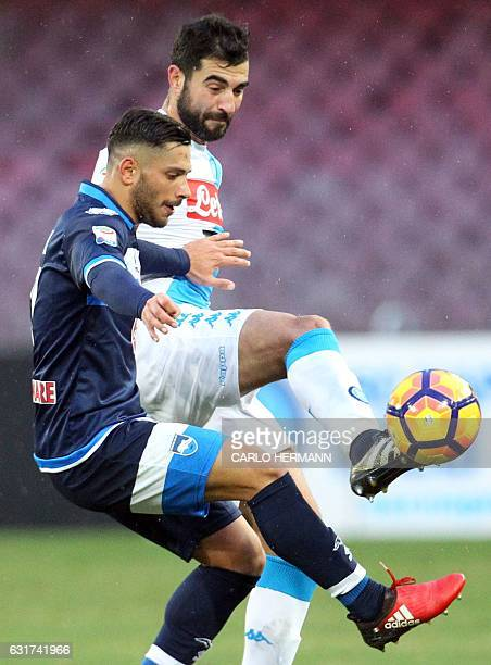 Napoli's Spanish defender Raul Albiol vies for the ball with Pescara's Italian forward from Italy Gianluca Caprari during the Italian Serie A...