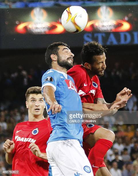 Napoli's Spanish defender Raul Albiol vies with Brugge's Brazilian forward Leandro Pereira near Brugge's Belgian defender Thomas Meunier during the...