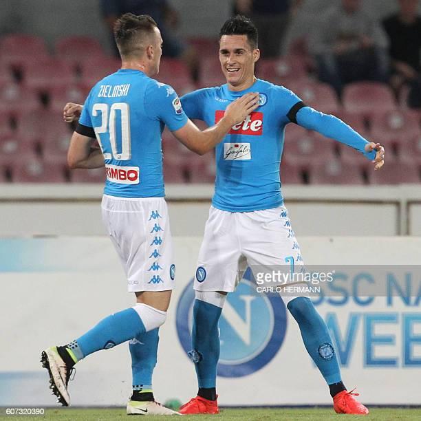 Napoli's Spanish forward Jose Maria Callejon celebrates with his teammate Polish midfielder Piotr Zielinski after scoring during the Italian Serie A...