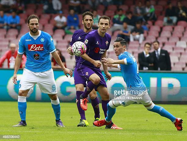 Napoli's Spanish forward Jose Maria Callejon eyes the ball during the Italian Serie A football match SSC Napoli vs ACF Fiorentina on October 18 2015...