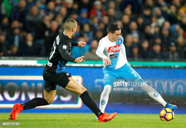 Napoli's Spanish forward Jose Maria Callejon fights for the ball with Atalanta'a Slovenian midfielder Jasmin Kurtic during the Italian Serie A...