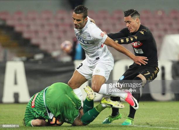 Napoli's Spanish forward Jose Maria Callejon fights for the ball with Udinese's Iraqi defender Ali Adnan as Udinese's Greek goalkeeper Orestis...