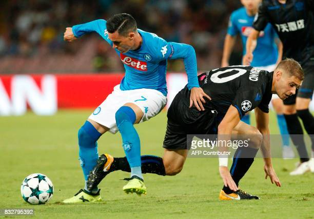 Napoli's Spanish forward Jose Maria Callejon fights for the ball with Nice's French defender Maxime Le Marchand during the UEFA Champions League Play...