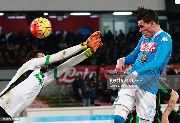 Napoli's Spanish forward Jose Maria Callejon jumps for a header to score against Sassuolo's Italian goalkeeper Andrea Consigli during the Italian...