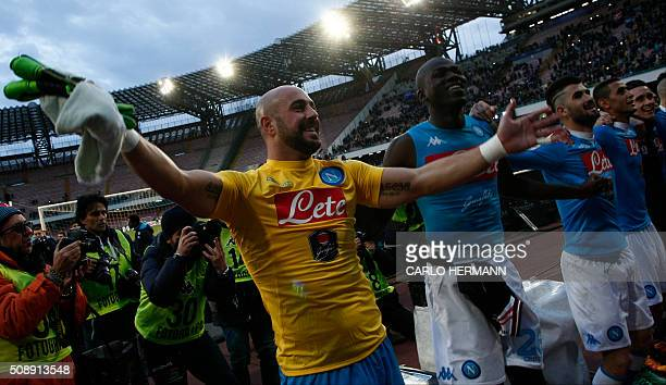 Napoli's Spanish goalkeeper Pepe Reina celebrates with teammate Napoli's French defender Kalidou Koulibaly at the end of the Italian Serie A football...