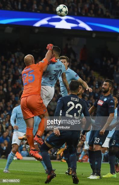 Napoli's Spanish goalkeeper Pepe Reina clears the ball from the path of Manchester City's Argentinian defender Nicolas Otamendi's head during the...