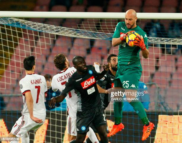 Napoli's Spanish goalkeeper Pepe Reina makes a save during the Italian Serie A football match SSC Napoli vs AC Milan on November 18 2017 at the San...