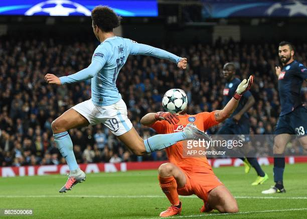 Napoli's Spanish goalkeeper Pepe Reina saves a shot from Manchester City's German midfielder Leroy Sane during the UEFA Champions League Group F...