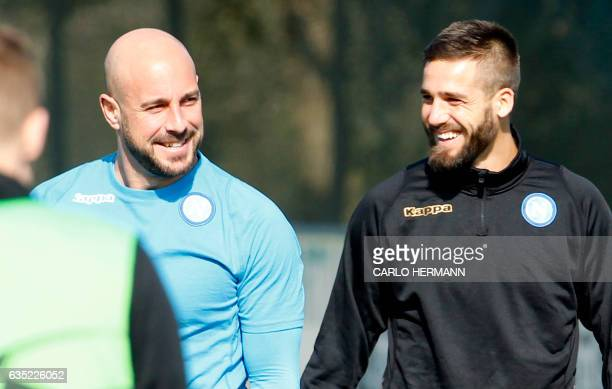 Napoli's Spanish goalkeeper Pepe Reina smiles near Napoli's Italian forward Leonardo Pavoletti during a training session on the eve of the UEFA...