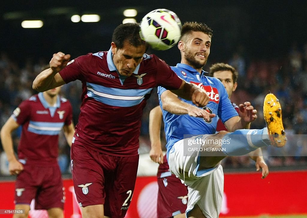 Napoli's Spanish midfielder David Lopez vies for the ball with Lazio's Italian midfielder Cristian Ledesma during the Italian Serie A football match...