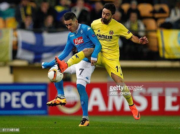 Napoli's Spanish midfielder Jose Maria Callejon vies wit Villarreal's midfielder Jaume Costa during the UEFA Europa League Round of 32 first leg...
