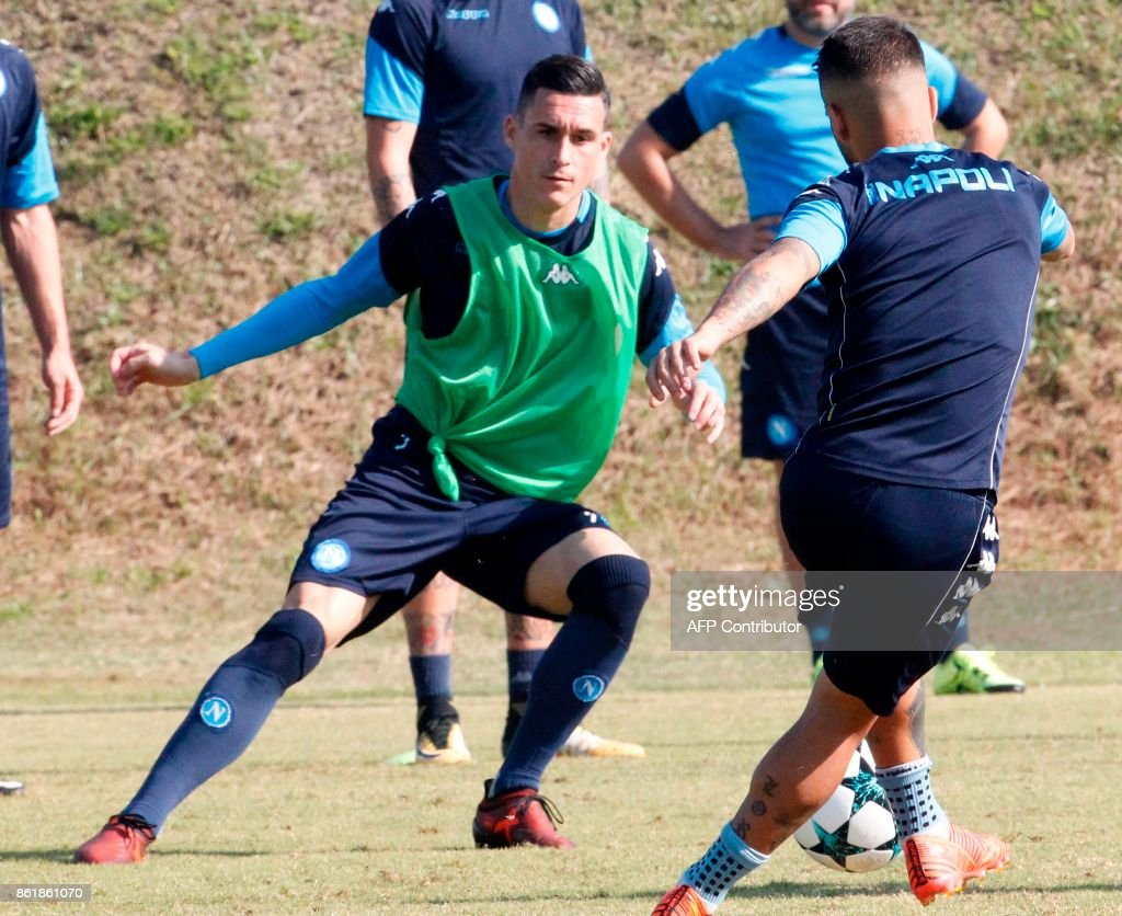 Napoli s Spanish striker Jose Maria Callejon L and Italian