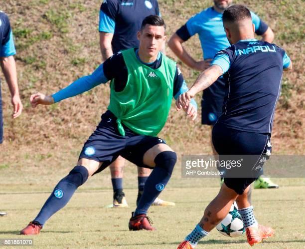 Napoli's Spanish striker Jose Maria Callejon and Italian striker Lorenzo Insigne attend a training session on the eve of the UEFA Champions League...
