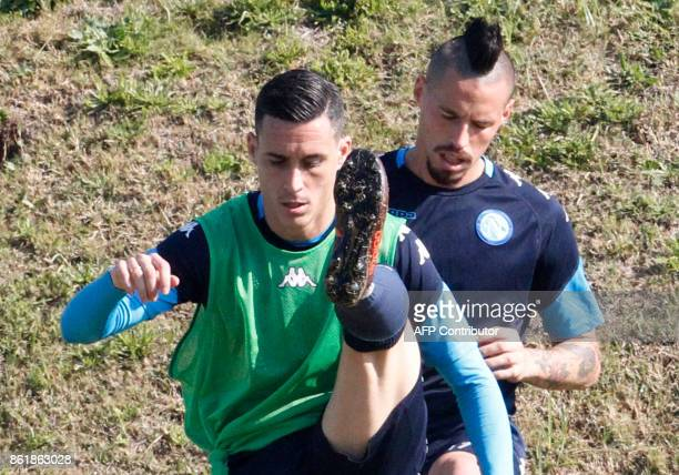 Napoli's Spanish striker Jose Maria Callejon and Napoli's Slovakian midfielder Marek Hamsik attend a training session on the eve of the UEFA...